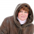A woman in a sheepskin coat with kupyushonom on a white background. — Stock Photo #10141761