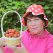 A woman with strawberry. — Stock Photo #10141951