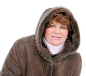 A woman in a sheepskin coat with kupyushonom on a white background. — Stockfoto
