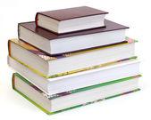 Stoh knih na bílém pozadí — Stock fotografie