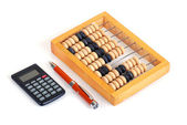Calculator, pen and wooden abacus — Stock Photo