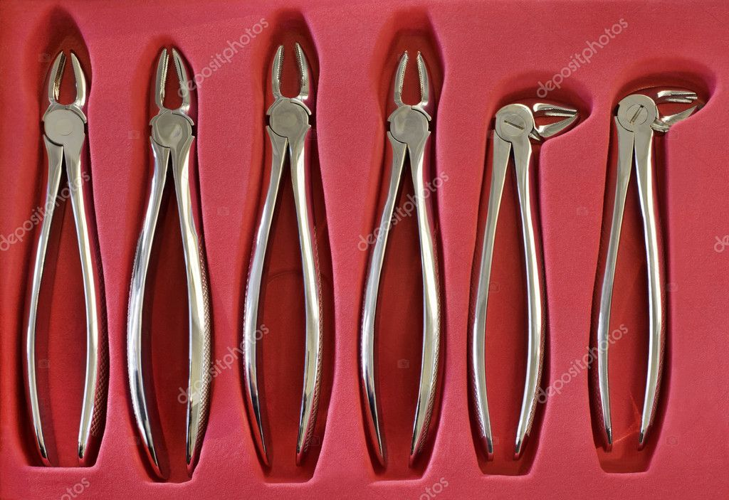 Collection of Dental Pliers in Red Case — Stock Photo #10732639
