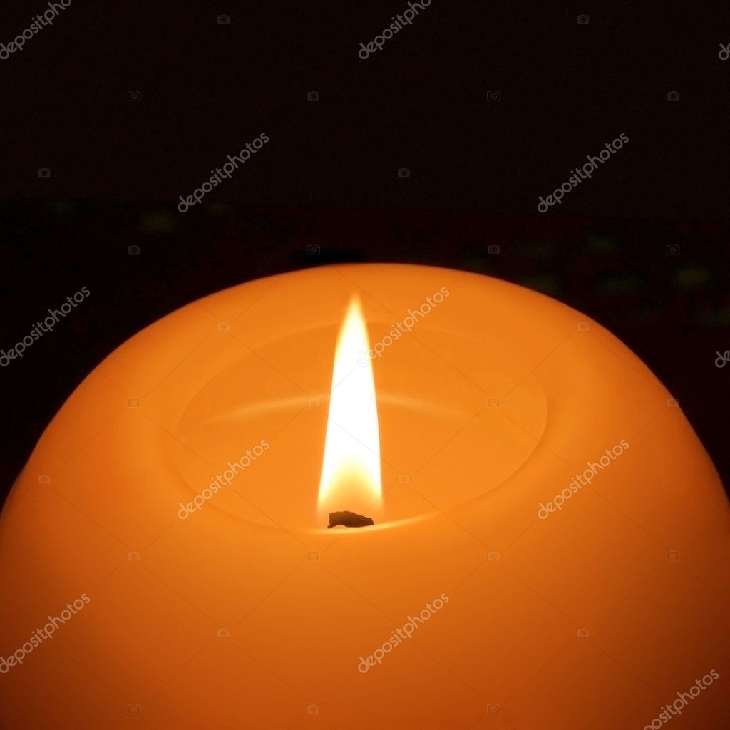 Burning candle isolated on black background — Stock Photo #9399200