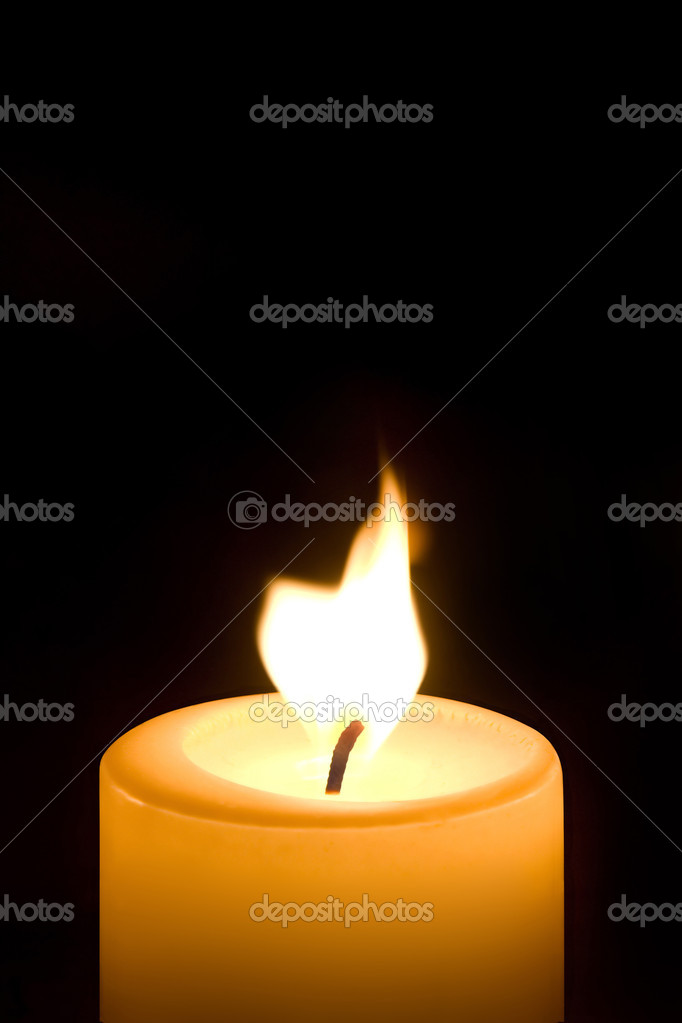 Burning candle isolated on black background — Stock Photo #9399262