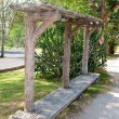 Long wooden bench — Stock Photo #10227553