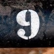 Stock Photo: The number 9 on rusted old iron surface
