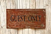The Drilled text of guest only on iron sheet background — Stock Photo