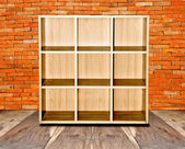 The Blank of wood shelf isolated on brickwall background — Stok fotoğraf