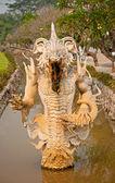 Lo status del diavolo a wat rong khun, chiangrai, Thailandia — Foto Stock