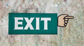 The Sign of exit painting hand on old wall — Stock Photo