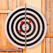 The Dartboard isolated on wood background — Stock Photo