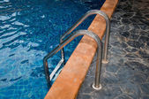 The Closeup of swimming pool with staircase at hotel — Stock Photo