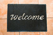 The Doormat of welcome text on wood background — Stock Photo