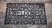 The Doormat curved steel of welcome text on floor background — Stock Photo