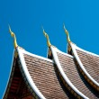 Royalty-Free Stock Photo: The Beautiful roof of temple on blue sky background