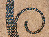 The Abstract ceramic spiral on pebble background — Stockfoto