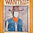 Wanted poster with blank face mask on wood wall -  