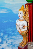 The Old sculpture of deva isolated on blue sky background — Stock fotografie
