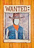Wanted poster with blank face mask on wood wall — Stock Photo