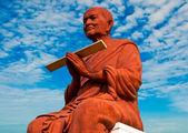 The Buddha status of Luang Phor Tho on blue sky background — Stock Photo