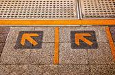 The Sign of yellow arrow on floor — Stock Photo