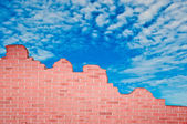 The Ruin of brickwall on blue sky background — Foto Stock