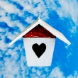 Royalty-Free Stock Photo: The Wooden of birdhouse on blue sky background