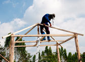 The Worker men climbing on structure wood — Stock Photo