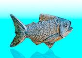上の魚の彫刻の背景を反映してください。 — ストック写真