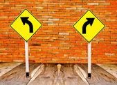The Guidepost turn left and turn right on wood floor and old br — Stock Photo