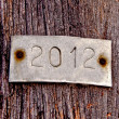 The Aluminum plate of 2012 on old wood background — Stock fotografie