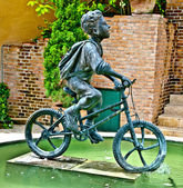 The Sculpture steel of boy ride bicycle monument — Stock Photo