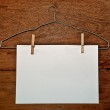 The White paper and hanger on wood background — Stock Photo