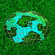 Stock Photo: Ceramic of whole world on green grass background