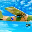 The Vintage plane of worlld war on blue sky background - Stock Photo