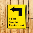 Stock Photo: Yellow plate post of food fusion restaurant