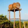 the oid water tank in farm — Stock Photo