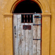 The Vintage wooden door for guest only - Стоковая фотография