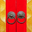 The Rusted knocker of red door chinese style - Stock Photo