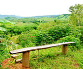 The Long wooden bench on mountain — Стоковое фото