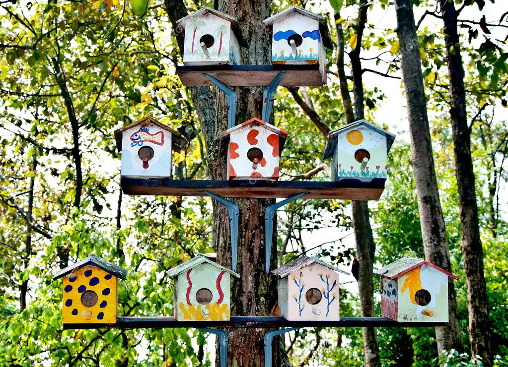 The Wooden of birdhouse family on tree — Stock Photo #10727600