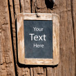 Royalty-Free Stock Photo: The Old wooden blackboard on wood background