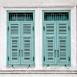 Royalty-Free Stock Photo: The Old window on wall background