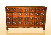 The Wooden cabinet with square drawers and white handle isolated — Stock Photo