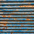 Rusty corrugated metal texture background — Stock Photo #9740828