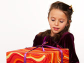 Little girl with a big gift — Stock Photo