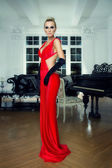 Elegant blonde in a red dress — Stock Photo