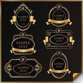 Black gold-framed labels — Stock Vector