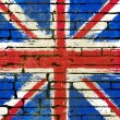 Union Jack on a Brick Wall Background — Stock Vector