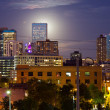 Stock Photo: Full Moon Rising Behind Denver Colorado Skyline at Dusk